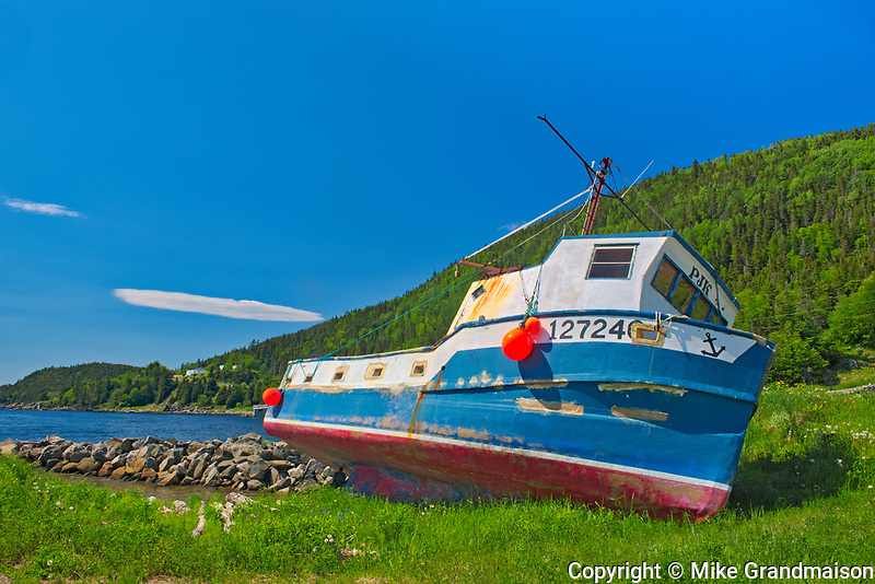 Fishing boat along the shoreline of White Bay. Baie Verte Peninsula.<br />