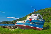 Fishing boat along the shoreline of White Bay. Baie Verte Peninsula.<br /><br />Newfoundland & Labrador<br />Canada