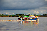colorful tourist boat is returning to Paramaribo