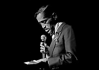 Sammy Davis Jr., reads a personal note to the audience at the opening of a benefit performance in Atlanta, March 10, 1981, to raise funds for the investigation into the deaths or disappearance of 21 Atlanta children. (AP Photo/Gary Gardiner)