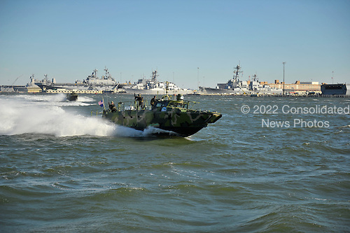 Sailors assigned to Riverine Group 1 conduct maneuvers Friday, October 22, 2010 aboard Riverine Command Boat (Experimental) (RCB-X) at Naval Station Norfolk. The RCB-X is powered by an alternative fuel blend of 50 percent algae-based and 50 percent NATO F-76 fuels to support the Secretary of the Navy's efforts to reduce total energy consumption on naval ships. .Mandatory Credit: Gregory N. Juday - U.S. Navy via CNP.