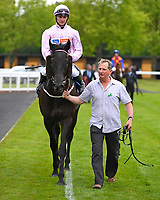 Winner of The Peter Symonds Catering Claiming Stakes       Oofy Prosser (pink) ridden by Mitch Godwin and trained by Harry Dunlop is led into the Winners enclosure during Afternoon Racing at Salisbury Racecourse on 16th May 2019