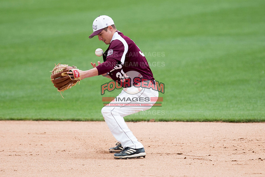 Travis McComack #31 of the Missouri State Bears bobbles a ball during a game against the Wichita State Shockers at Hammons Field on May 5, 2013 in Springfield, Missouri. (David Welker/Four Seam Images)