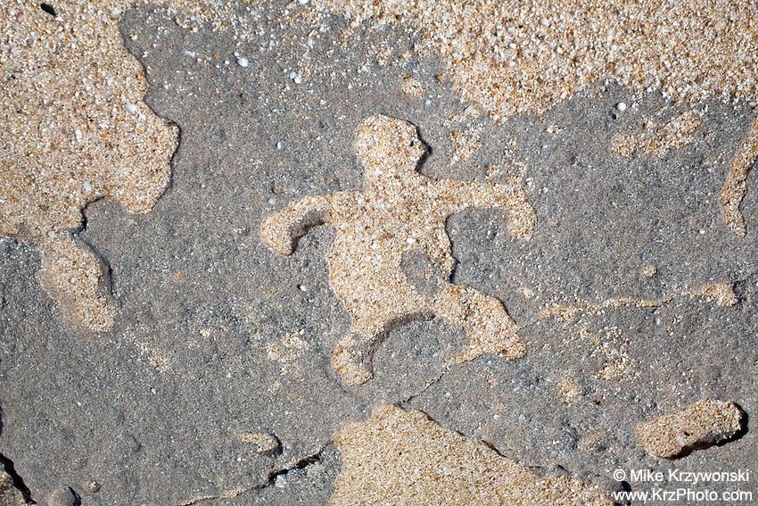 Hawaiian petroglyphs on sandstone along the shore of Keiki Beach, North Shore, Oahu, Hawaii