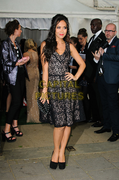 Myleene Klass.Women Of The Year 2012 - Glamour Awards, Berkeley Square, London, England..29th May 2012.full length dress black lace hand on hip clutch bag.CAP/CJ.©Chris Joseph/Capital Pictures.
