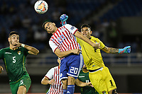 PEREIRA - COLOMBIA, 22-01-2020: Hugo Fernandez de Paraguay disputa el balón con Jose Carrasco  y Ruben Cordano , arquero, de Bolivia durante partido entre Paraguay y Bolivia por la fecha 2, grupo B, del CONMEBOL Preolímpico Colombia 2020 jugado en el estadio Hernan Ramirez Villegas en Pereira, Colombia. / Hugo Fernandez of Paraguay fights the ball with Jose Carrasco nd Ruben Cordano (goalkeeper) of Bolivia during the match between Paraguay and Bolivia for the date 2, group B, for the CONMEBOL Pre-Olympic Tournament Colombia 2020 played at Hernan Ramirez Villegas stadium in Pereira, Colombia. Photo: VizzorImage / Julian Medina / Cont