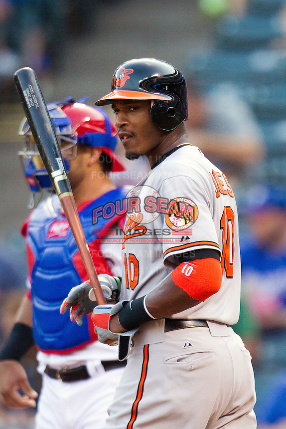 Baltimore Orioles outfielder Adam Jones #10 walks to the plate during the Major League Baseball game against the Texas Rangers on August 21st, 2012 at the Rangers Ballpark in Arlington, Texas. The Orioles defeated the Rangers 5-3. (Andrew Woolley/Four Seam Images).