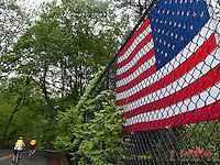 Westport, Connecticut - 17 May 2009 - American Flag hangs on the fence of an overpass in Fairfield County.