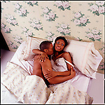 African American couple embracing in bed