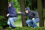 06/01/11--Two Tualatin residents point towards an adult black bear in a field between Tualatin Elementary School and an industrial park along SW 95th Avenue....Photo by Jaime Valdez...........................................
