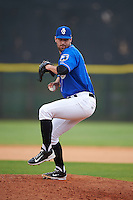Biloxi Shuckers pitcher Austin Ross (12) delivers a pitch during a game against the Birmingham Barons on May 24, 2015 at Joe Davis Stadium in Huntsville, Alabama.  Birmingham defeated Biloxi 6-4 as the Shuckers are playing all games on the road, or neutral sites like their former home in Huntsville, until the teams new stadium is completed in early June.  (Mike Janes/Four Seam Images)