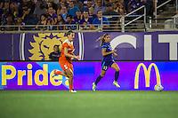 Orlando, FL - Thursday June 23, 2016: Cari Roccaro, Alex Morgan during a regular season National Women's Soccer League (NWSL) match between the Orlando Pride and the Houston Dash at Camping World Stadium.