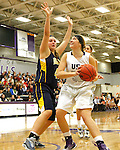 SIOUX FALLS, SD - JANUARY 2:  Sam Knecht #50 from the University of Sioux Falls eyes the basket past Naomi Rust #42 from Augustana in the first half of their game Friday night at the Stewart Center. (Photo by Dave Eggen/Inertia)