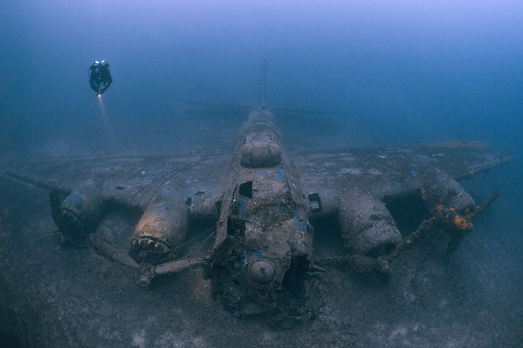 Diver exploring the wreck of a B17G  Flying Fortress, Vis, Croatia, which lies at 72 metres
