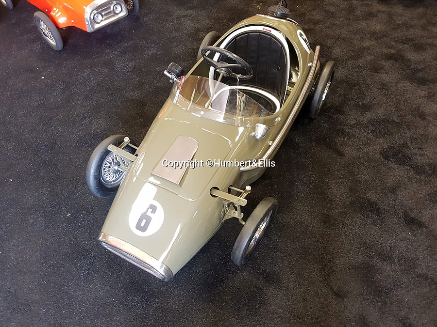BNPS.co.uk (01202 558833)<br /> Pic: Humbert&Ellis/BNPS<br /> <br /> A Tri-ang pedal racecar from the 1960's, est. £2,250.<br /> <br /> £200,000 of pedal power...<br /> <br /> A remarkable single owner collection of over 85 vintage toy cars has emerged for sale for £200,000.<br /> <br /> The fleet of rare pedal cars which were acquired over half a century form what is thought to be the biggest private collection of its kind in the world.<br /> <br /> It includes child car models of Rolls Royces, Bugattis and Bentleys, as well as a quirky amphibian car. <br /> <br /> The collection has been consigned for sale with Humbert & Ellis Auctioneers by a retired businessman in his 80s.<br /> <br /> He travelled all over the world to get his hands on the cars, and built a barn next to his Devon home to display them in.