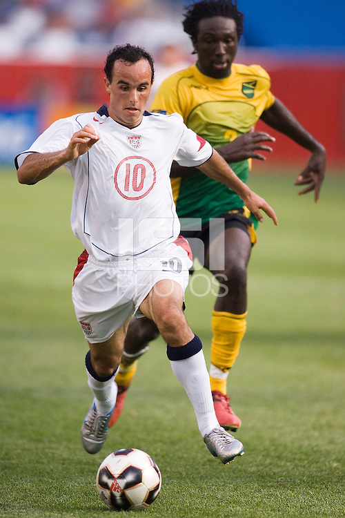USA's Landon Donovan is trailed by Jamaica's Damion Stewart. The United States defeated Jamaica 3 to 1 in quarterfinal CONCACAF Gold Cup action at Gillette Stadium, Foxbourgh, MA, on July 16, 2005.