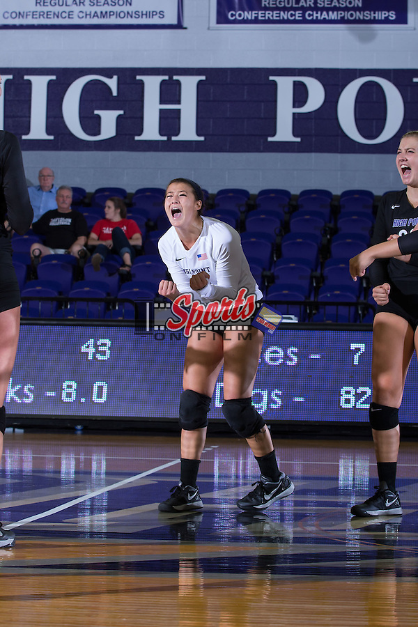 Annemarie Chin (14) of the High Point Panthers celebrates after her team scored a point against the Marshall Thundering Herd at the Panther Invitational at the Millis Athletic Center on September 12, 2015 in High Point, North Carolina.  The Thundering Herd defeated the Panthers 3-2.   (Brian Westerholt/Sports On Film)
