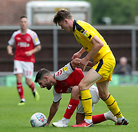 Fleetwood Town's Ched Evans battles with Oxford United's Rob Dickie<br /> <br /> Photographer David Shipman/CameraSport<br /> <br /> The EFL Sky Bet League One - Oxford United v Fleetwood Town - Saturday August 11th 2018 - Kassam Stadium - Oxford<br /> <br /> World Copyright &copy; 2018 CameraSport. All rights reserved. 43 Linden Ave. Countesthorpe. Leicester. England. LE8 5PG - Tel: +44 (0) 116 277 4147 - admin@camerasport.com - www.camerasport.com