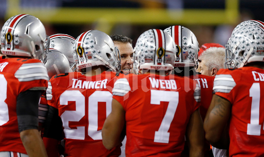 Ohio State Buckeyes head coach Urban Meyer talks to his team late in the fourth quarter during the College Football Playoff National Championship at AT&T Stadium in Arlington, TX on Monday, January 12, 2015. (Columbus Dispatch photo by Jonathan Quilter)