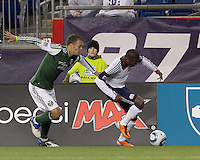 New England Revolution forward Sainey Nyassi (17) dribbles down the wing as Portland Timbers midfielder Jack Jewsbury (13) defends. In a Major League Soccer (MLS) match, the New England Revolution tied the Portland Timbers, 1-1, at Gillette Stadium on April 2, 2011.