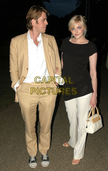 BEN ELLIOT & SOPHIE DAHL.Serpentine Gallery summer party, Hyde Park, London, .9th July 2002..full length black top cream trousers.Ref:PL.© Capital Pictures.sales@capitalpictures.com.www.capitalpictures.com.