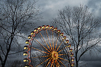 A fairy Wheel in Hamburg set against a dramatic winter sky, Germany