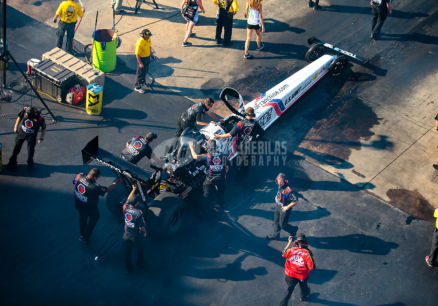 Jun 16, 2018; Bristol, TN, USA; Crew members for NHRA top fuel driver Antron Brown during qualifying for the Thunder Valley Nationals at Bristol Dragway. Mandatory Credit: Mark J. Rebilas-USA TODAY Sports