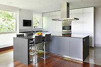 A modern 'Okin' kitchen by Bulthaup in an open-plan kitchen/dining and living room