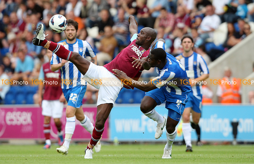 Carlton Cole of West Ham and Magnus Okuonghae of Colchester - Colchester United vs West Ham United, Pre-season Friendly at The Weston Homes Community Stadium - 21/07/12 - MANDATORY CREDIT: Rob Newell/TGSPHOTO - Self billing applies where appropriate - 0845 094 6026 - contact@tgsphoto.co.uk - NO UNPAID USE.