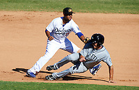 Mesa Solar Sox second baseman Rafael Ynoa #5, of the Los Angeles Dodgers organization, tags out Nick Franklin #6 during an Arizona Fall League game against the Peoria Javelinas at HoHoKam Park on October 15, 2012 in Mesa, Arizona.  Peoria defeated Mesa 9-2.  (Mike Janes/Four Seam Images)