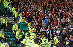 Ajax fans rip up seats and throw them at Celtic fans and stewards after goal
