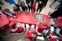 STANFORD, CA - April 23, 2011: The Stanford baseball team signs autographs for fans after Stanford's game against UCLA at Sunken Diamond. Stanford won 5-4.
