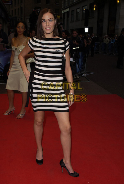 "LINZI STOPPARD.World Premiere of ""Three"" at the Odeon West End, Leicester Square, London, UK..May 2nd, 2006.Ref: CAN.full length black white striped stripes dress Lindsay Lindsey.www.capitalpictures.com.sales@capitalpictures.com.©Capital Pictures"