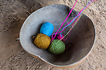 Knitting thread in a large calabash bowl in a Wayuu rancheria or rural settlement.  Knitting, crocheting and weaving are fundamental to the social and economic lives of Wayuu women in La Guajira, Colombia.