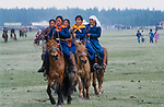 Women on their way to the Naadam festival, Mongolia <br /> <br /> The games are Mongolian wrestling, horse racing, and archery, and are held throughout the country during midsummer. Women have started participating in the archery and girls in the horse-racing games, but not in Mongolian wrestling.