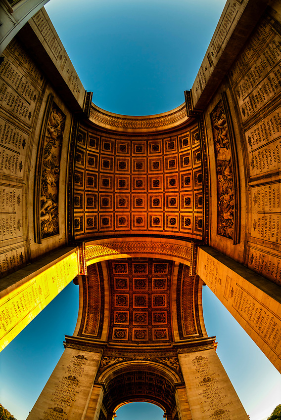 View looking up from underneath the Arc de Triomphe (The Arc de Triomphe de l'Étoile) is one of the most famous monuments in Paris, France, standing at the western end of the Champs-Élysées at the centre of Place Charles de Gaulle, formerly named Place de l'Étoile.