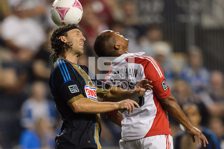 Jeff Parke (31) of the Philadelphia Union goes up for a header with Robert Earnshaw (10) of Toronto FC. The Philadelphia Union defeated Toronto FC 1-0 during a Major League Soccer (MLS) match at PPL Park in Chester, PA, on October 5, 2013.