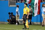 15 July 2015: Assistant Referee Eric Boria (USA) has a laser shined on his face after call offside against Mexico. The Mexico Men's National Team played the Trinidad & Tobago Men's National Team at Bank of America Stadium in Charlotte, NC in a 2015 CONCACAF Gold Cup Group C match.