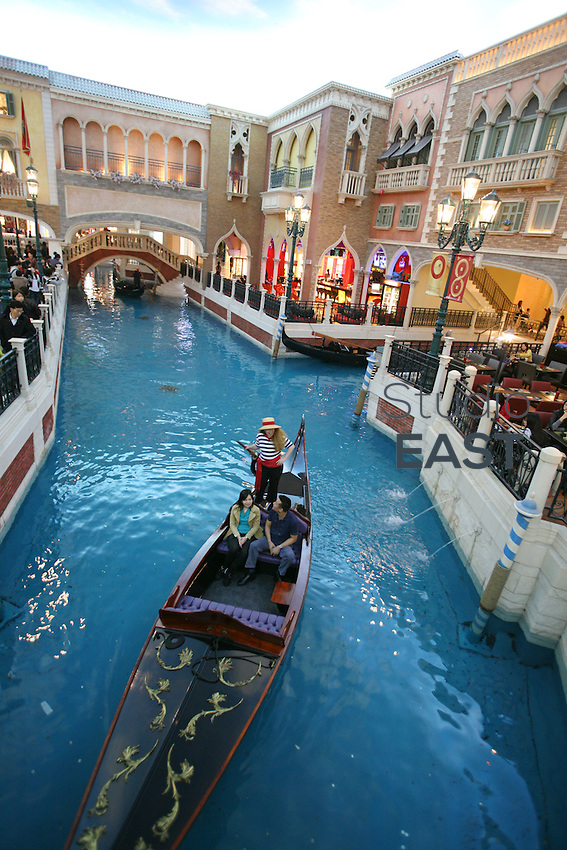 A gondola sails on a fake canal under a fake sky at the Venetian casino's shopping mall in Macau, China, on February 24, 2008. The Venetian Macao-Resort-Hotel is a 163,000 square foot casino featuring 405 slots and 277 table games. Macao has overtaken Las Vegas with a gambling revenue of 7 billion U.S. dollars in 2006 (Las Vegas' was 6.6 billion U.S. dollars), and is now the world's top casino hut. Photo by Lucas Schifres/Pictobank