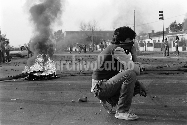 2  Julio 1986<br /> Jornadas de protesta nacional del 2 y 3 de Julio de 1986, en los incidentes mas graves del dia 2 resulto muerta por balas militares una nina de 12 anios en la poblacion Los Copihues de La Florida y los jovenes Carmen Gloria Quintana y Rodrigo Rojas fueron quemados vivos por una patrulla militar en el sector Av. General Velasquez<br /> Forty years ago, on September 11, 1973, a military coup led by General Augusto Pinochet toppled the democratic socialist government of Chile. President Salvador Allende was killed during the  attack to seize  La Moneda presidential palace.  In the aftermath of the coup, a quarter of a million people were detained for their political beliefs, 3000 were killed or disappeared and many thousands were tortured.<br /> Some years later in 1981, while Pinochet ruled Chile with iron fist, a young photographer called Juan Carlos Caceres started to freelance in the streets of Santiago and the poblaciones or poor outskirts, showing the growing resistance against the dictatorship. For the next 10 years Caceres photographed every single protest and social movement fighting for the restoration of democracy. He knew that his camera was his only weapon, he knew that his fate was to register the daily violence and leave his images for the History.<br /> In this days Caceres is working to rescue and organize his collection of images in the project Imagenes de la Resistencia   . With support of some Chilean official institutions, thousands of negatives are digitalized and organized to set up the more complete visual heritage of this  violent period of Chile&acute;s history.<br /> In a time when technology was not very friendly and communications were kind of basic, Juan Carlos Caceres and other photojournalist were always at the right place in the right moment defying the threats of the police. Their work is now  a visual heritage that documents and remind us the fight of Chilean people for democracy.