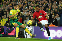 27th Ocotber 2019; Carrow Road, Norwich, Norfolk, England, English Premier League Football, Norwich versus Manchester United; Anthony Martial of Manchester Utd attempts to flick the ball around Ben Godfrey of Norwich City - Strictly Editorial Use Only. No use with unauthorized audio, video, data, fixture lists, club/league logos or 'live' services. Online in-match use limited to 120 images, no video emulation. No use in betting, games or single club/league/player publications