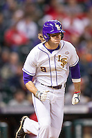 LSU Tigers outfielder Mark Laird (9) hustles down the first base line during the NCAA baseball game against the Houston Cougars on March 6, 2015 at Minute Maid Park in Houston, Texas. LSU defeated Houston 4-2. (Andrew Woolley/Four Seam Images)