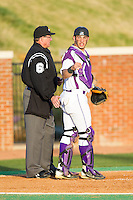 High Point Panthers catcher Josh Spano (21) looks to the dugout for the sign during the game against the Coastal Carolina Chanticleers at Willard Stadium on March 14, 2014 in High Point, North Carolina.  The Panthers defeated the Chanticleers 3-0.  (Brian Westerholt/Four Seam Images)