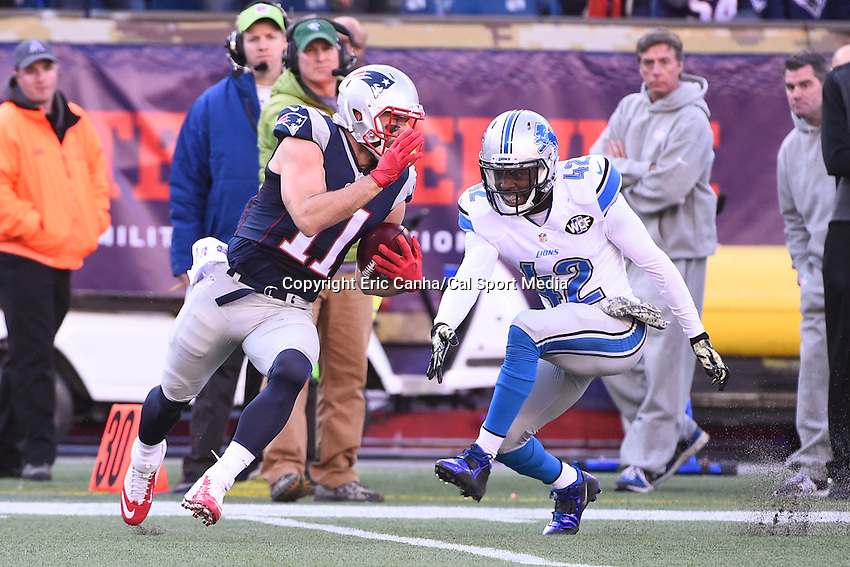 November 23, 2014 - Foxborough, Massachusetts, U.S.- New England Patriots wide receiver Julian Edelman (11) avoids a tackle by Detroit Lions strong safety Isa Abdul-Quddus (42) during the NFL game between the Detroit Lions and the New England Patriots held at Gillette Stadium in Foxborough Massachusetts. The Patriots defeated the Lions 34-9. Eric Canha/CSM