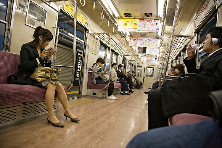 Interior view of train with commuters in Himeji Japan