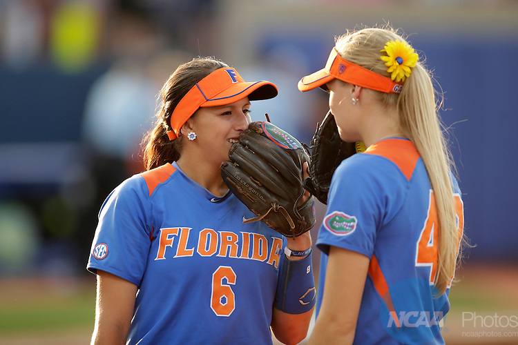 02 JUNE 2014:   Katie Medina (6) and Taylor Schwarz (49) of the University of Florida talk things over against the University of Alabama during the Division I Women's Softball Championship held at ASA Hall of Fame Stadium in Oklahoma City, OK.  Shane Bevel/NCAA Photos