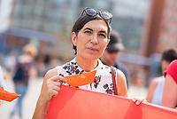 """Ca. 200 Menschen versammelten sich am Samstag den 4. August 2018 in Berlin auf dem Potsdamer Platz zu einem Flashmob unter dem Motto """"Seenotrettung ist kein Verbrechen"""". Sie protestierten damit gegen die Abschottungspolitik Europas und das defacto Verbot der zivilen Seenotrettung im Mittelmeer. Aufgrund dieses Verbots sind binnen 6 Wochen ueber 700 Menschen bei ihrer Flucht ueber das Mittelmeer nach Europa ertrunken.<br /> Im Bild: Selmin Caliskan von der Seenotrettungsorganisation SOS Mediterranee. Sie war bis September 2016 Generalsekretaerin von Amnesty International Deutschland.<br /> 4.8.2018, Berlin<br /> Copyright: Christian-Ditsch.de<br /> [Inhaltsveraendernde Manipulation des Fotos nur nach ausdruecklicher Genehmigung des Fotografen. Vereinbarungen ueber Abtretung von Persoenlichkeitsrechten/Model Release der abgebildeten Person/Personen liegen nicht vor. NO MODEL RELEASE! Nur fuer Redaktionelle Zwecke. Don't publish without copyright Christian-Ditsch.de, Veroeffentlichung nur mit Fotografennennung, sowie gegen Honorar, MwSt. und Beleg. Konto: I N G - D i B a, IBAN DE58500105175400192269, BIC INGDDEFFXXX, Kontakt: post@christian-ditsch.de<br /> Bei der Bearbeitung der Dateiinformationen darf die Urheberkennzeichnung in den EXIF- und  IPTC-Daten nicht entfernt werden, diese sind in digitalen Medien nach §95c UrhG rechtlich geschuetzt. Der Urhebervermerk wird gemaess §13 UrhG verlangt.]"""