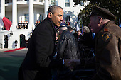 United States President Barack Obama greets a military veteran during an arrival ceremony on the South Lawn of the White House in Washington, D.C., U.S., on Tuesday, Feb. 11, 2014. <br /> Credit: Andrew Harrer / Pool via CNP
