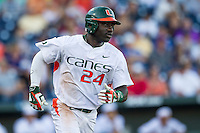 Miami Hurricanes outfielder Jacob Heyward (24) runs to first base during the NCAA College baseball World Series against the Arkansas Razorbacks  on June 15, 2015 at TD Ameritrade Park in Omaha, Nebraska. Miami beat Arkansas 4-3. (Andrew Woolley/Four Seam Images)