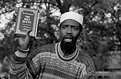 A Muslim preacher addresses a crowd at Speakers Corner, Hyde Park, London